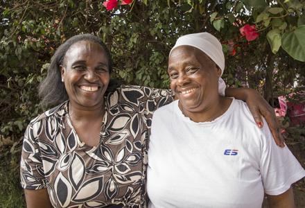 Friends Susan Wairimu, 50, and Sarah kuria, 63, at a Wezesha Jamii meeting in Kawangware, an informal settlement in Nairobi, Kenya. Photo: Katie G. Nelson/Oxfam