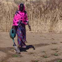 Fatna Bakhit, 22, relies on market gardening to feed her family. Photo: Oxfam